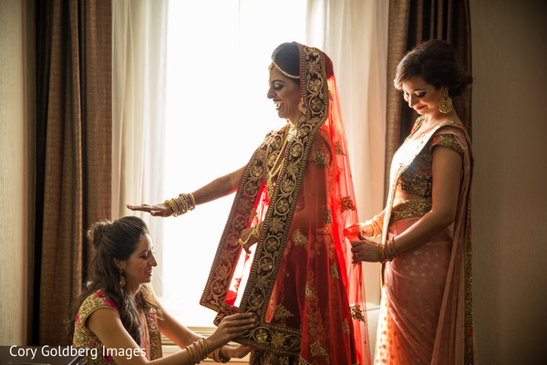 Candid shot of indian bride getting ready.