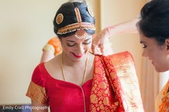 South indian bride gets some help to get ready for her big day.