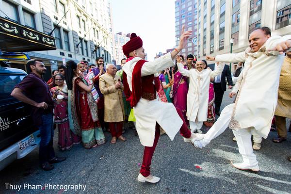 Groom dancing before wedding ceremony