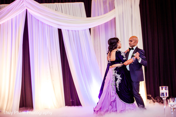 Indian couple dancing at wedding reception