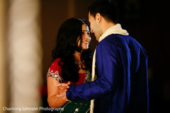 Sweet moment of bride and groom at the sangeet.