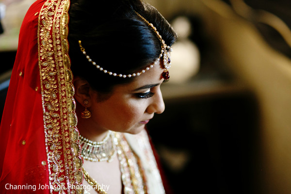 Indian bride getting looking perfect in her bridal attire.