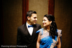 Indian couple in matching blue outfits.