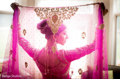 Indian bride with hot pink dupatta.
