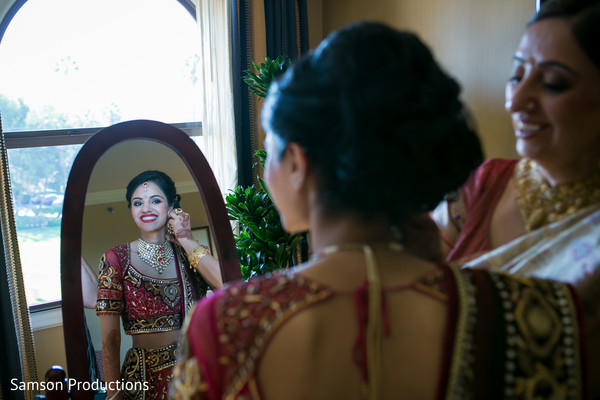 indian bride hair and makeup,indian bride getting ready,indian bridal fashions