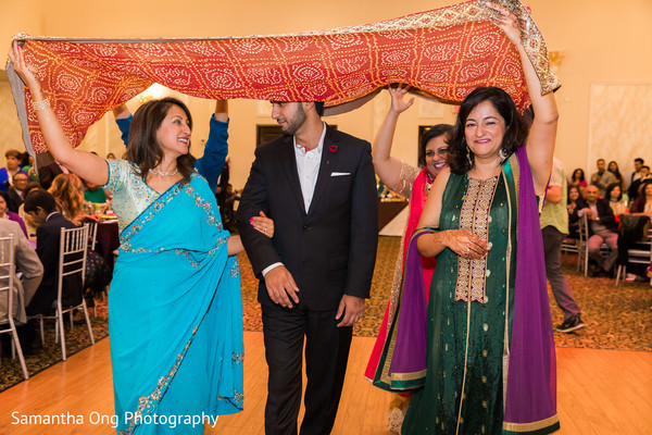 Indian groom entering the sangeet.