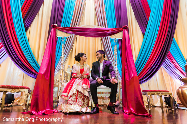 Beautiful indian couple in a traditional jhoola swing.