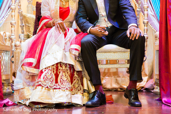 Enchanting shot of indian bride and groom at their sangeet night.