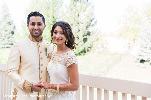 Perfect indian couple in cream and white matching outfits.