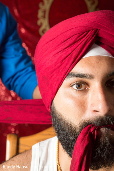Sikh indian groom geeting ready.