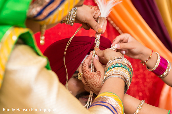 Final touch ups to the groom's turban.