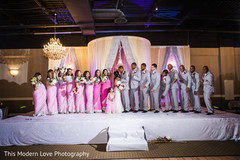 Indian couple with bridesmaids and groomsmen at wedding reception