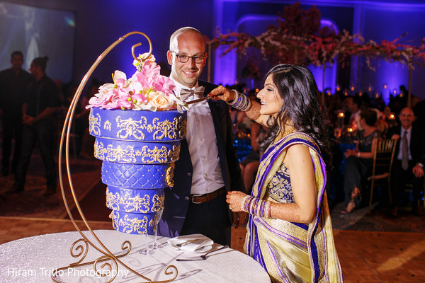 Indian couple cutting their wedding cake in Dallas, TX Fusion Wedding by Hiram Trillo Art Photography