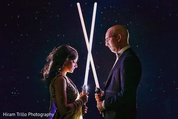 Lovely indian couple with star wars light sabers at wedding reception in Dallas, TX Fusion Wedding by Hiram Trillo Art Photography