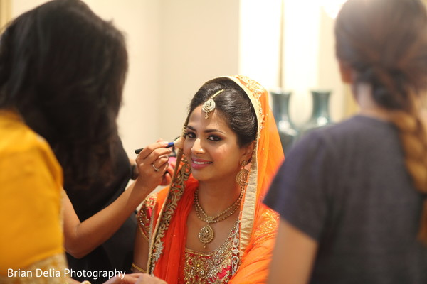 indian bride getting ready,indian bride hair and makeup,pre-wedding ceremony photography