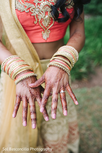 Indian bride showing her mehndi art before garba ceremony in Spartanburg, SC, Fusion Wedding by Sol Basconcillo Photography