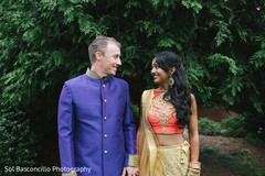 Happy indian bride and groom photo session before garba ceremony