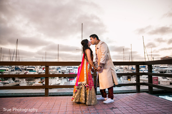 Indian bride and groom sunset portrait.