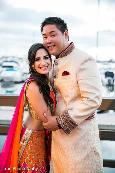 Indian bride and groom in pre-wedding outfits.