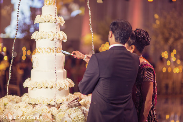 indian wedding cakes,cutting the cake