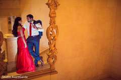 red dress,outdoor indian wedding photo shoot,indian groom fashion