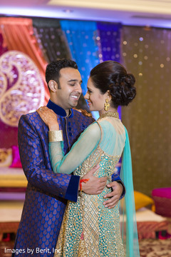 Indian couple hugging at sangeet ceremony