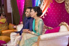Indian couple having fun at sangeet ceremony