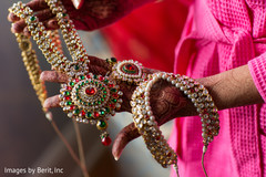 Indian bride showing her jewelry and mehndi art