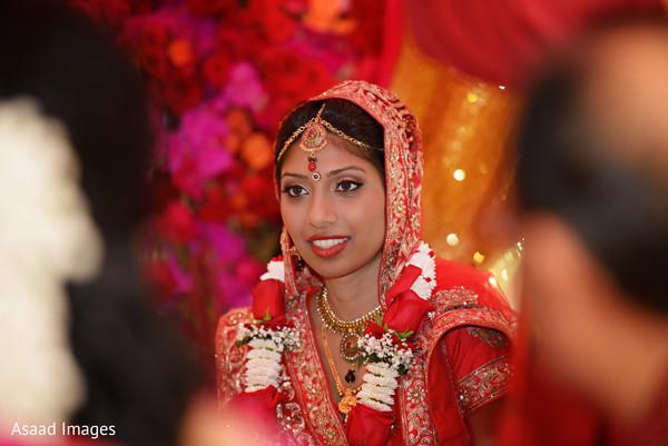 bridal tikka,indian wedding ceremony photography,indian wedding ceremony floral and decor