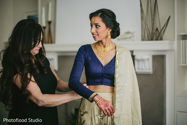 indian bride getting ready,indian bride hair and makeup,indian bridal fashions