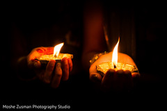 Indian couple holding candles
