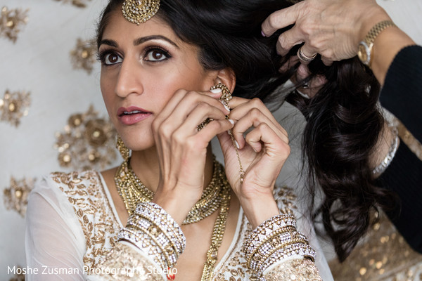 pre-wedding ceremony photography,bridal tikka,indian bride getting ready