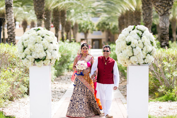 Stunning bride entering the ceremony. in Nieuwpoort, Curaçao Indian Wedding by KSD Weddings