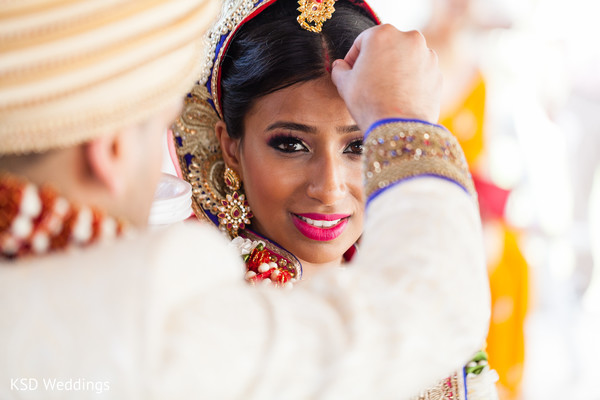 Sindoor marriage ceremony ritual. in Nieuwpoort, Curaçao Indian Wedding by KSD Weddings