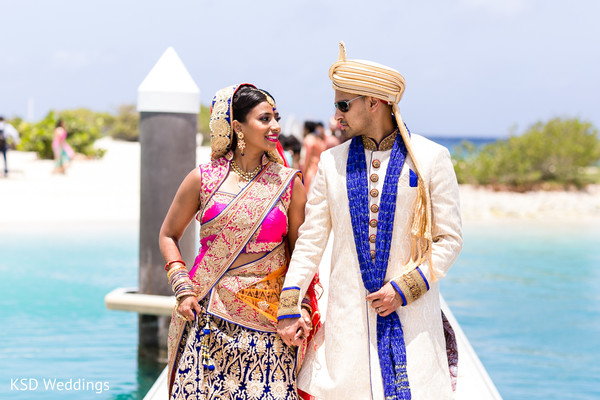 Bride and groom beach wedding photography. in Nieuwpoort, Curaçao Indian Wedding by KSD Weddings