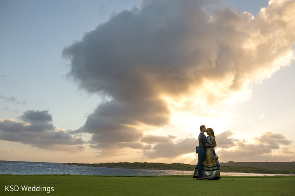 Indian couple's astonishingly sunset photography.  in Nieuwpoort, Curaçao Indian Wedding by KSD Weddings