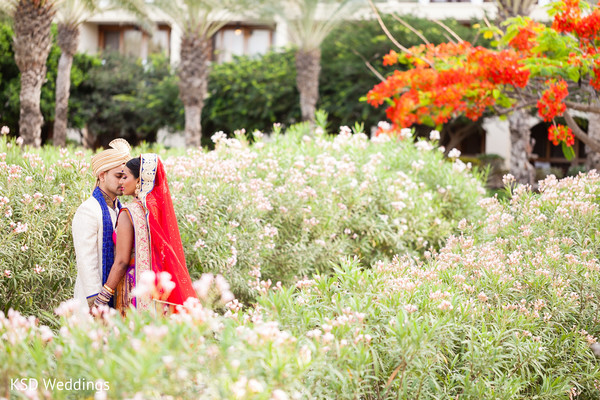 Indian bride and groom garden photo. in Nieuwpoort, Curaçao Indian Wedding by KSD Weddings