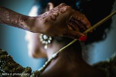 indian bride,indian bride getting ready,indian wedding mehndi