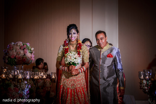 Indian bride walking down the aisle. in Cincinnati, OH Indian Wedding by Nadia D Photography