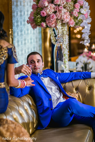 Bride and groom drinking champagne. in Cincinnati, OH Indian Wedding by Nadia D Photography