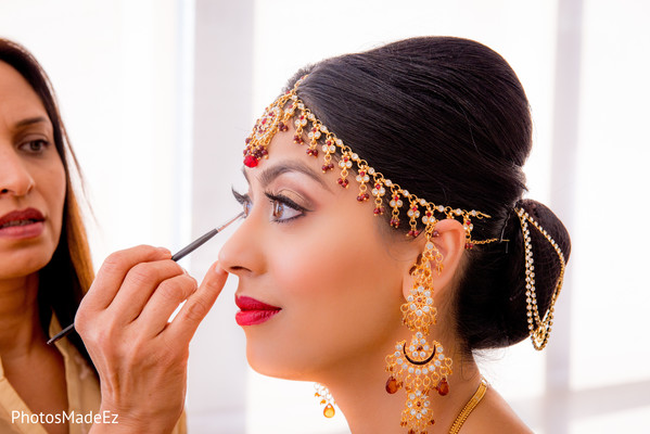 indian bride hair and makeup,indian bridal jewelry,pre-wedding ceremony photography