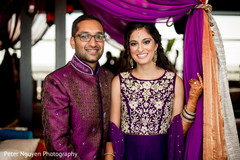 Lovely indian couple smiling at sangeet ceremony