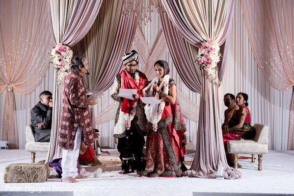 Indian couple reading their vows at wedding ceremony