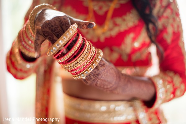 Gorgeous red and gold bangles in Wellesley, Massachusetts Fusion Indian Wedding by Irena Mandel Photography