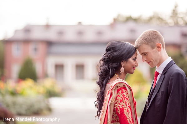 Indian couple in reception outfits in Wellesley, Massachusetts Fusion Indian Wedding by Irena Mandel Photography