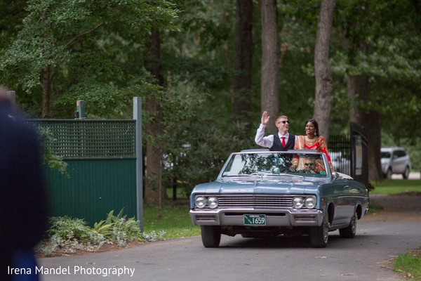 Bride and groom in classic car in Wellesley, Massachusetts Fusion Indian Wedding by Irena Mandel Photography
