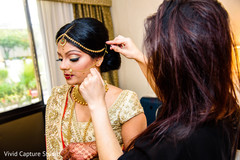 indian bride,indian bride getting ready,indian bridal jewelry