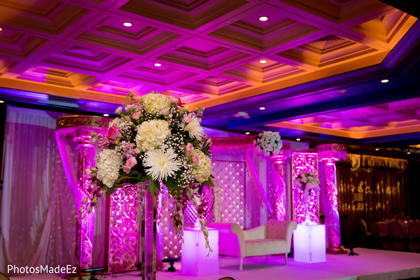 Hot pink themed reception stage.