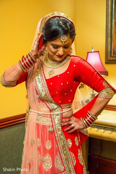 Gorgeous red and gold bridal lengha