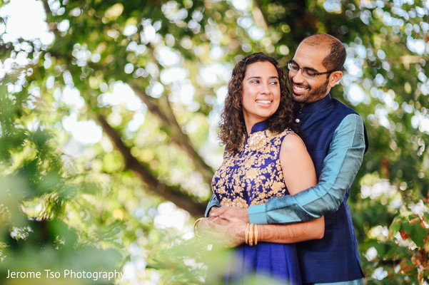 Indian couple hugging before sangeet ceremony